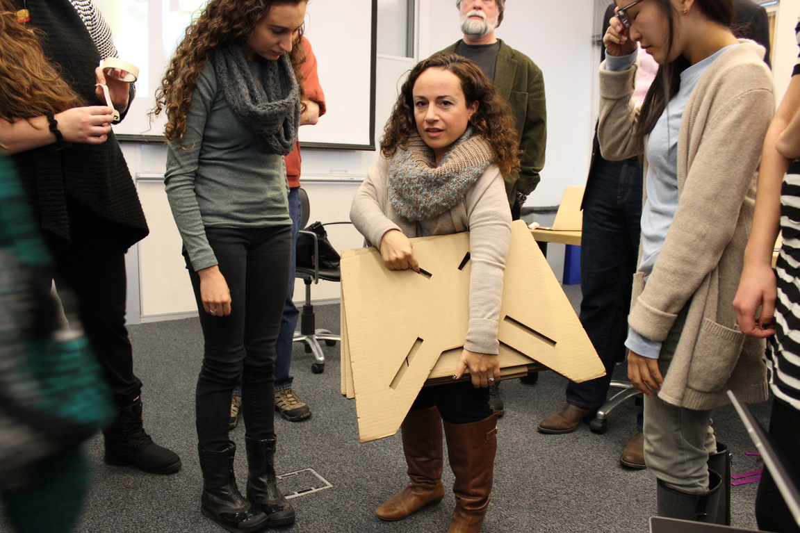 Amanda visits the class, cardboard model in hand.