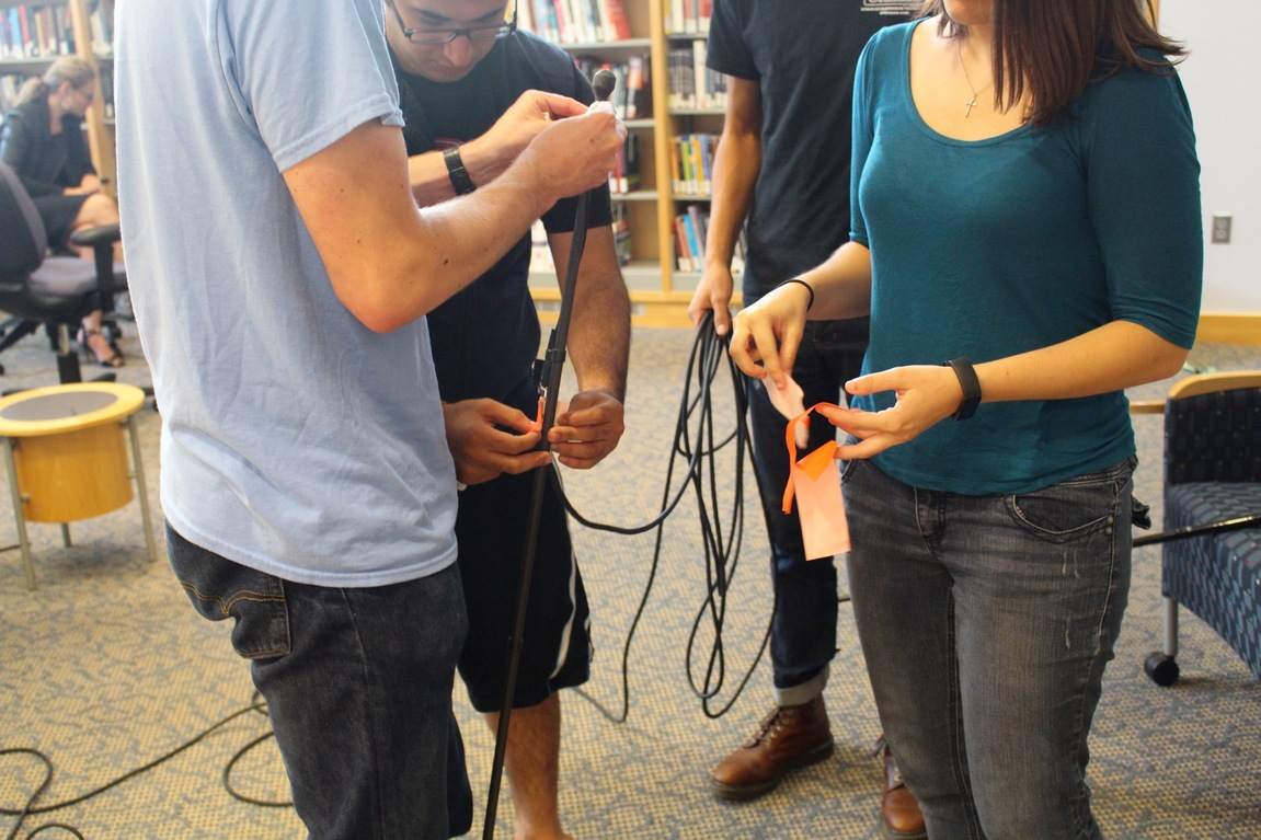 Students wire together the amped cane sketch model.
