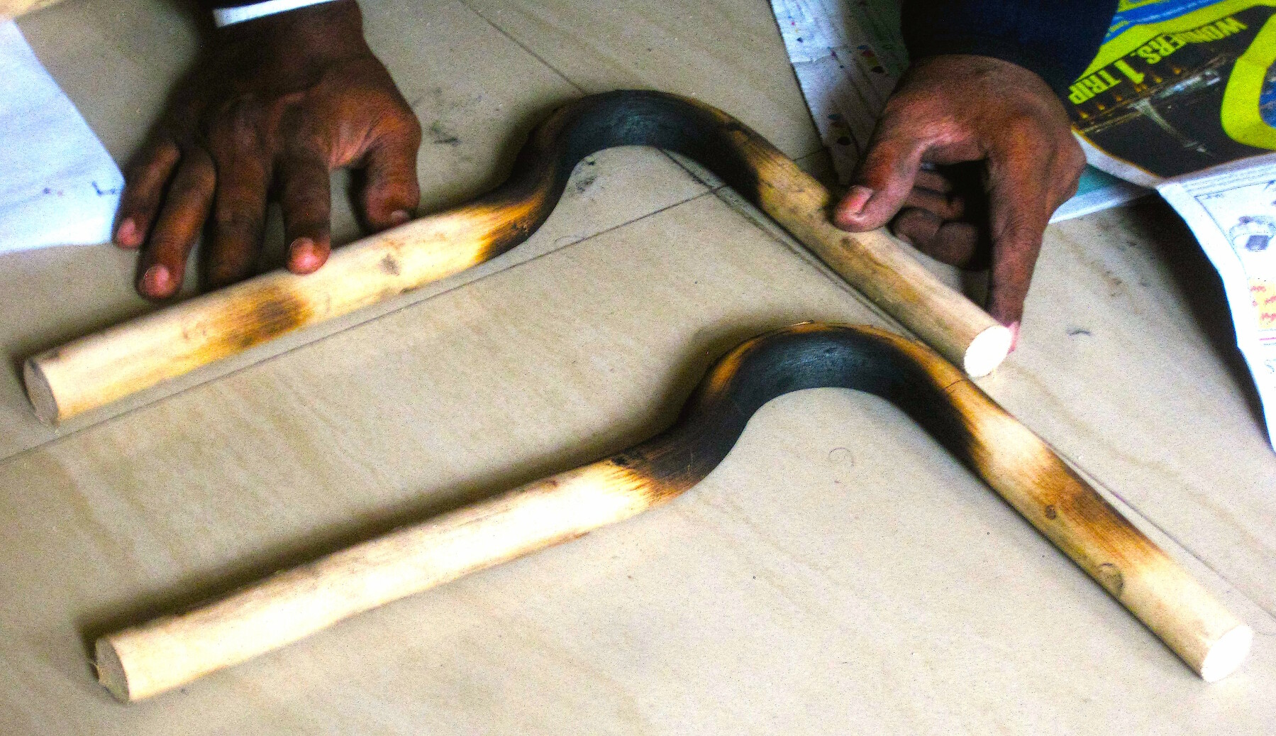 At Rise Legs in Bangalore, India, artificial legs are custom made for amputees using low-cost cane. Here, a fabricator bends and shapes the cane in a curve.