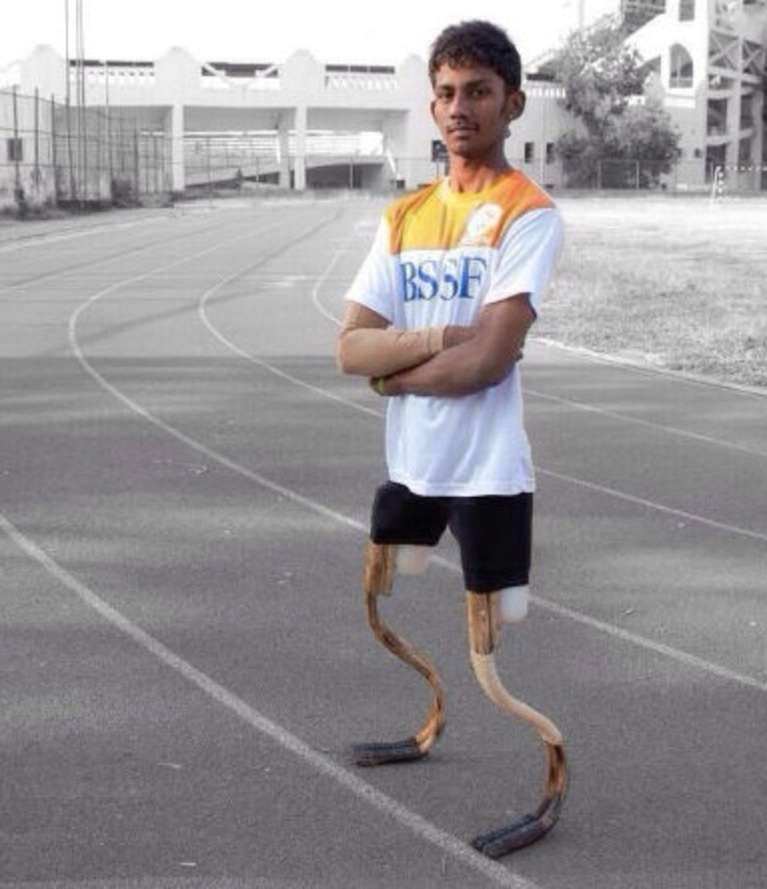 An athlete wears two Rise Legs, standing upright.